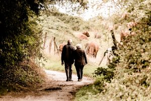 old people walking towards benistar benefits