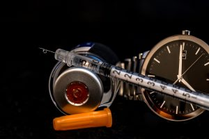 insulin syringe and watch