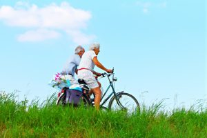 elderly couple with bicycles